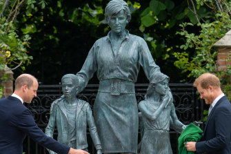 William and Harry unveil the statue that displays Diana's maternal and charitable instincts.