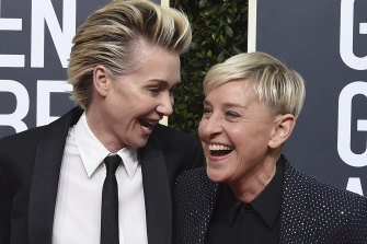 Portia de Rossi and Ellen DeGeneres arrive at the 77th annual Golden Globe Awards.
