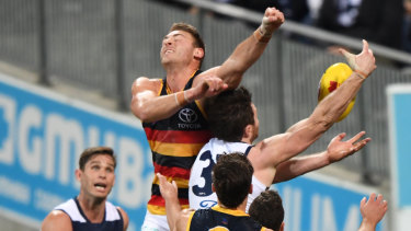 Flying high: Patrick Dangerfield and Daniel Talia battle for the ball last night.