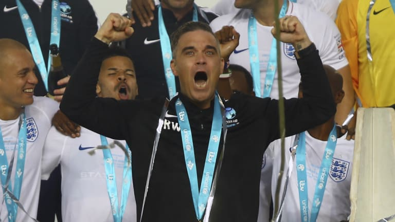 Robbie Williams at Old Trafford, Manchester on Sunday. The singer has been criticised for agreeing to perform at the World Cup's opening ceremony in Russia.