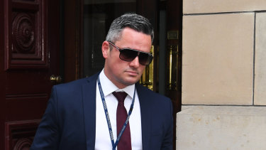 Detective Senior Constable Murray Gentner leaves the Supreme Court on Thursday.