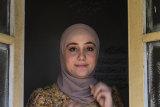 Author Rawah Arja.