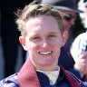 Michael Poy is one of two jockeys being investigated for breaching racing's COVID-19 protocols.
