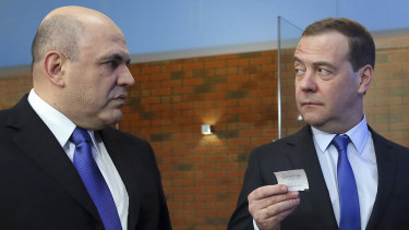 Russian Tax Service chief Mikhail Mishustin, left, listens to Russian Prime Minister Dmitry Medvedev in February.