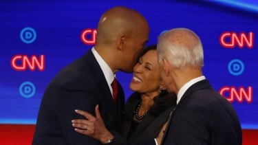 Cory Booker, Joe Biden and Kamala Harris talk after the second of two Democratic presidential primary debates.