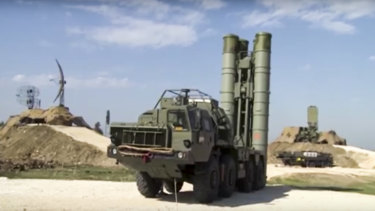 China has also bought technology associated with Russian S-400 air defence missiles, seen here  being deployed at the Hemeimeem air base in Syria.