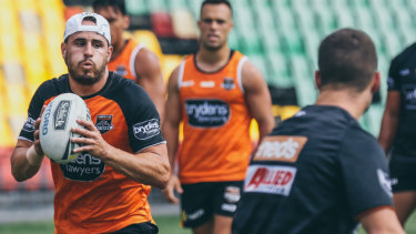 In the running: Josh Reynolds has some experienced competition for the five-eight role at the Tigers.