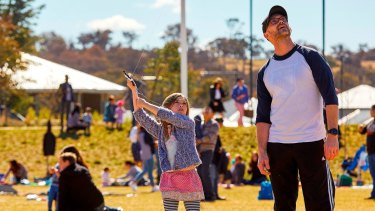 Dan and Poppy Fasch, of Googong, try their hand at kite flying at the Flying High event in Googong.