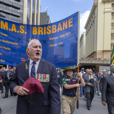 Soldiers from the H.M.A.S. Brisbane march during the Anzac Day parade in Brisbane/