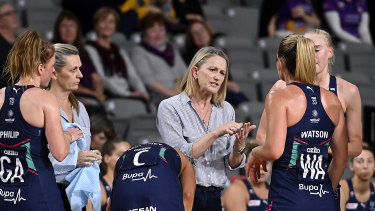 One game to go for premiership glory: Head coach Simone McKinnis (centre) with her Vixens.