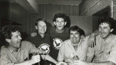 The Coodabeen Champions photographed at Sunshine FC in 1985. Left to right: Ian Cover, Simon Whelan, Greg Champion, Tony Leonard and Jeff Richardson.