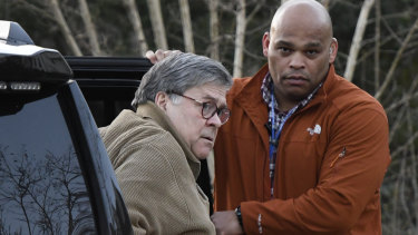 US Attorney General William Barr arrives at his home in Virginia on Saturday evening, facing some momentous decisions.