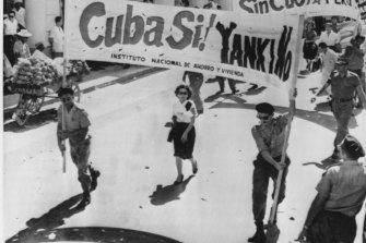 """Cuban """"People's Militia"""" march through the Havana streets in a prelude to an anti-United States rally on July 10, 1960."""