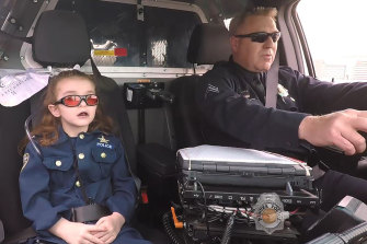 Olivia Gant, who was 6 years old at the time, rides with Captain Tim Scudder on a call in Denver.