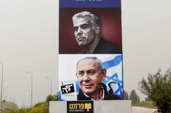 An election campaign billboard for Israeli Prime Minister Benjamin Netanyahu (bottom) and opposition candidate Yair Lapid prior to the March 23 election.