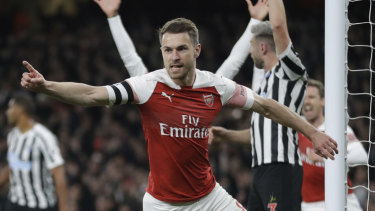 Opener: Arsenal talisman Aaron Ramsey celebrates scoring the Gunners' first against Newcastle.