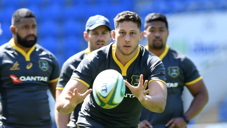 Pressure: Adam Coleman, receiving the ball at training, knows the Wallabies need to lift.