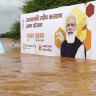 A billboard featuring Prime Minister Narendra Modi is partially submerged in flood waters at Kolhapur in western Maharashtra state, India.
