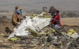 Rescuers at the scene of the Ethiopian Airlines crash. What role in the MAX disaster did Boeing's directors play?