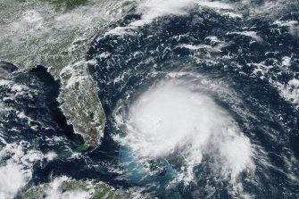 A satellite image shows Hurricane Dorian churning over the Atlantic Ocean on Sunday.