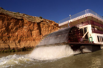 A paddlewheel boat passes beneath the Murray River gorges - an area once flooded by a 200km lake.