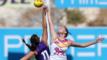 Parris Laurie (left) of the Dockers and Lauren Bella of the Lions contest the ball during the Round 2 AFLW match at Fremantle Oval on Sunday.