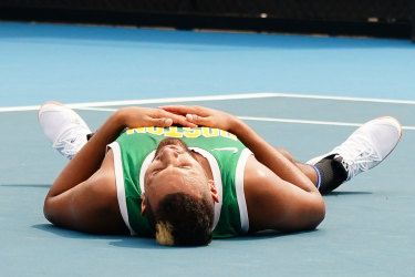 Nick Kyrgios of Australia collapses at the end of his training session.