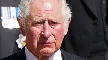 Prince Charles with other family members follows the coffin of Prince Philip.