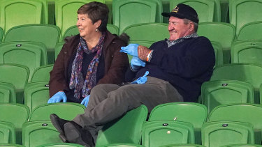 Having a ball: The parents of Storm debutant Chris Lewis report for duty.