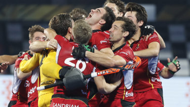 Belgian players celebrate their win over Netherlands in the gold medal game at the Men's Hockey World Cup at Kalinga Stadium in Bhubaneswar, India on Sunday.