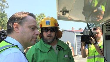 Brisbane lord mayor Adrian Schrinner met with SES volunteers in Newmarket on Tuesday morning.