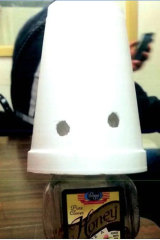 A honey bottle made up to look like a Ku Klux Klan member was allegedly left in the breakroom at Pinto Mining Group.