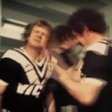 Tom Raudonikis getting his face slapped by a teammate before a game against Manly.