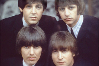 Robert Freeman played a key role in capturing the early image of the Beatles, pictured here in 1965.