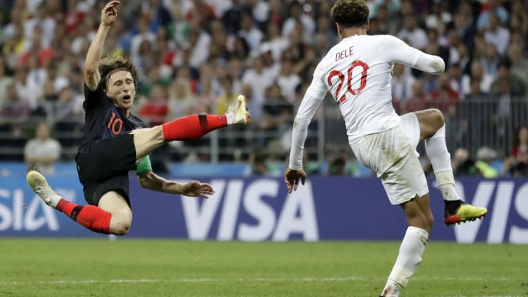 Croatia's Luka Modric, left, challenges England's Dele Alli.