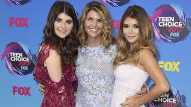 Lori Loughlin, centre, pictured with daughters Bella and Olivia at the Teen Choice Awards in 2017.