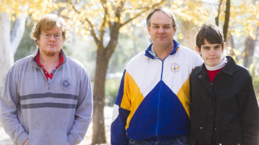 John Donovan (centre) and his two sons Nicholas (L) and Cameron (R) may struggle under potential changes to the NDIS.