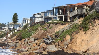 Coast-dwellers ordered to evacuate after 30m of beach washed away