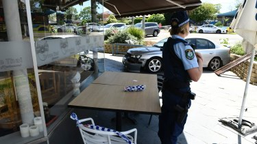 Police officers at the restaurant, scene of the car accident in North Epping on Friday.
