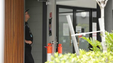 Police monitor entrances to the Hotel Grand Chancellor in Brisbane.