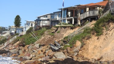 Storm-damaged sand dunes and beachfront houses at Wamberal.