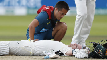 Steve Smith receives treatment after being hit on the side of the neck on day four of the second Ashes Test.