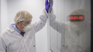 Britain's Prime Minister Boris Johnson visits a laboratory in Livingston, Scotland.
