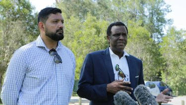 Family spokesman Ali Kadri with Raghe Abdi's father, Mohammad, at Calamvale District Park on Friday, December 18.