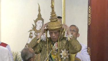 Thai King Maha Vajiralongkorn adjusts his crown at his coronation on Saturday.