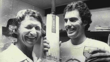 Sam Trimble and Greg Chappell with celebration beers at the Brisbane Cricket Ground in 1975.