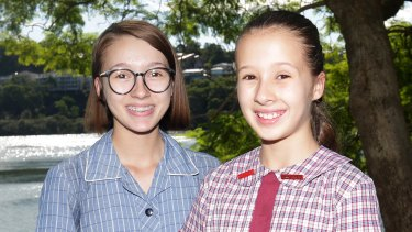 Grace Bricknell (left) and little sister Lily are going to different high schools.