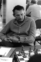 Josef Tarnawski playing chess in the 1960s. He remembers a mistake enabled him to defeat Russian Grandmaster Alexander Kotov in Brisbane in 1963.