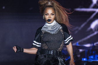 Janet Jackson performs at the 2018 Essence Festival in New Orleans. She's auctioning more than 1000 outfits and a prized car.