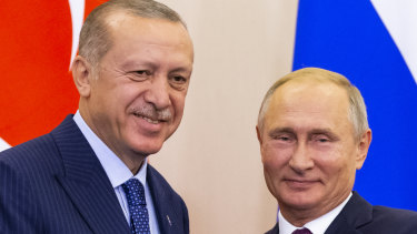 Russian President Vladimir Putin, right, and Turkish President Recep Tayyip Erdogan shake hands after their joint news conference following the talks in Sochi, Russia,